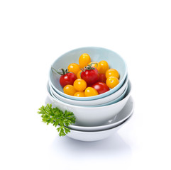 clean bowls, assorted fresh cherry tomato and parsley, isolated