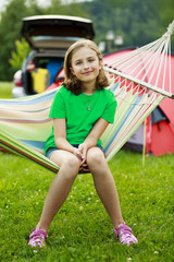 Summer in the tent - girl with family on the camping
