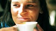 Woman drinking coffee in restaurant, closeup, steadycam shot
