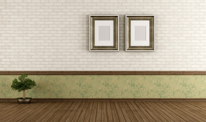 Empty vintage room with brick wall and blank frame - rendering