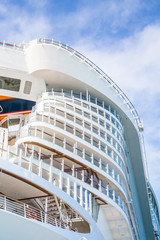 Curving Cruise Ship Decks Rising Into Sky