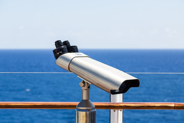 Silver Spotting Scope on Deck of a Cruise Ship