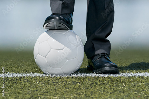 Businessman with a soccer ball
