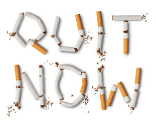 Text ''quit now'' made from broken cigarettes