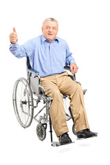 Senior man in a wheelchair giving a thumb up