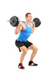 Full length portrait of man lifting heavy weight