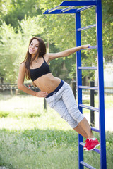 Beautiful young woman on the sports ground