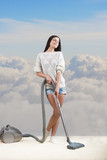 Girl dreams while she tidies up the room, cloudy sky background poster