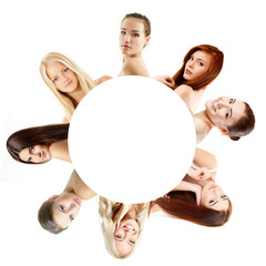 Group of beautiful girls, faces closeup over white