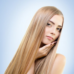 Hair. Beautiful bond girl with healthy long hair. Haicare and ha