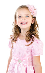 Adorable smiling little girl in pink princess dress isolated