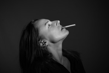 Woman on giving up smoking with cigarette in mouth