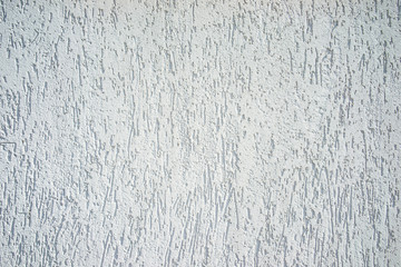 Muro bianco ruvido al sole