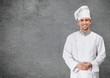 Portrait of smiling chef cook, isolated on grey background