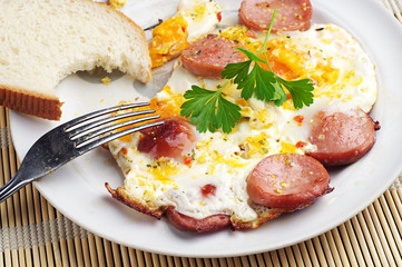 Breakfast with eggs and sausage