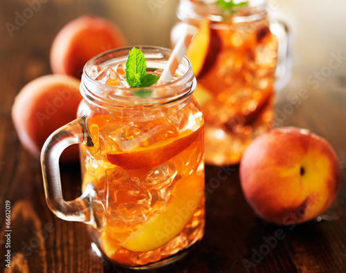 jar of peach tea shot with selective focus