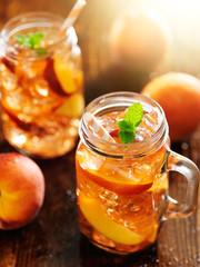 jar of peach tea shot vertically
