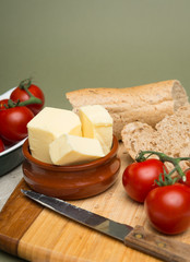 Delicious organic home-made bread and butter with ripe tomatoes
