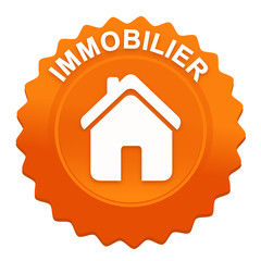 immobilier sur bouton web denté orange