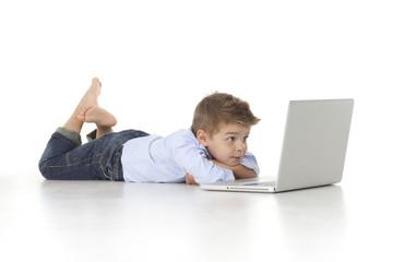 child looks at laptop