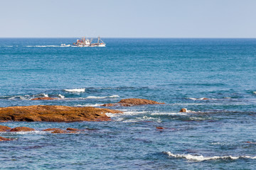 Fishing boat goes on Atlantic Ocean. Tangier, Morocco