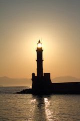 Lighthouse silhouette at sunset Chania Crete