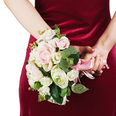 Wedding bouquet from white and pink roses in hands of bride.