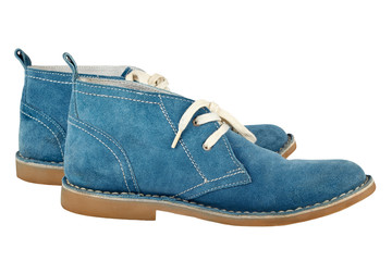 A pair of blue  suede  shoes with white  laces isolated on a whi