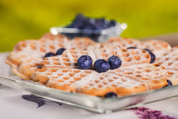 Sweet waffles for breakfast on wooden table