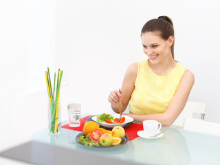 Close-up Of Beautiful Woman Eating healthy food