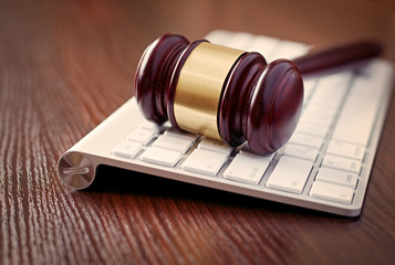 Wooden judges gavel on a computer keyboard