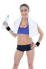 Strong blonde holding water bottle smiling at camera