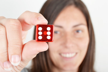young woman showing a dice