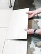Laying down floor tiles