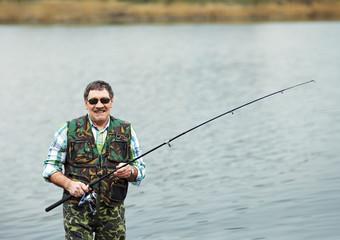 Portrait of mature fisherman