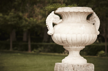 Antique marble pots in a garden.