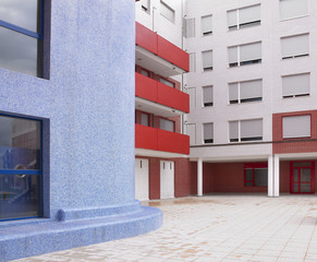 Residential building facade in white, blue and red tone