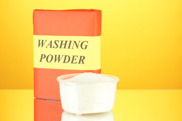 Box of washing powder with measuring cup,