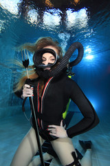 Scuba woman with spear gun