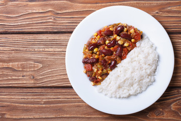 Chili con carne and rice on a white plate top view