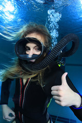 Scuba woman with black neoprene dive suit