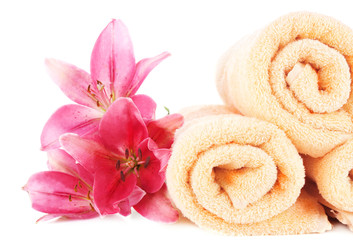 Color towels and lily flowers, isolated on white