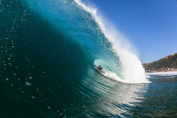 Surfing Rider Inside Large Hollow Blue Wave