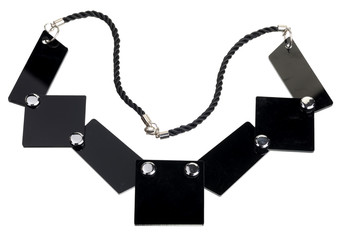 Necklace of black flat plates, isolated