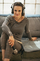 Portrait of young woman with headphones and microphone