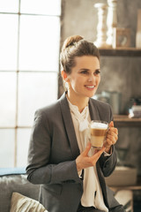 Portrait of happy business woman with coffee latte