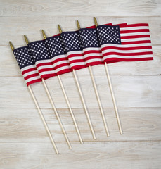 United of America Flags on white faded wood