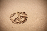 Peace symbol on the sand beach