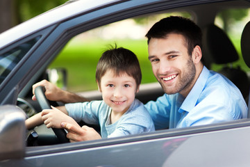 Father and son sitting in a car