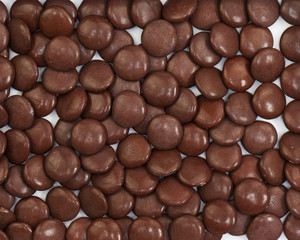 Dark brown dragee in chocolate covered.